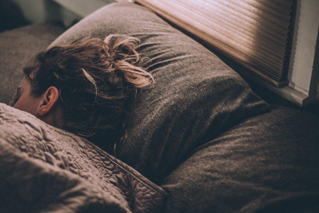 Female sleeping in bed.