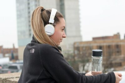 Girl resting after exercise with headphones on