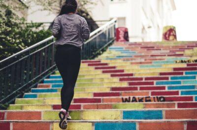 Girl Running Up Steps