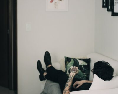 Guy relaxing on sofa